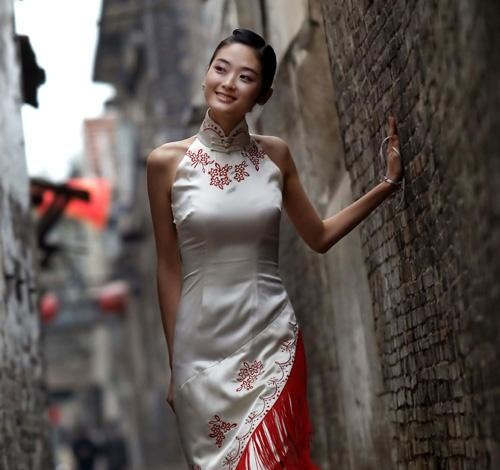 Chinese girl in dress off to Starbucks
