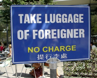 take-luggage-of-foreigner-400x322